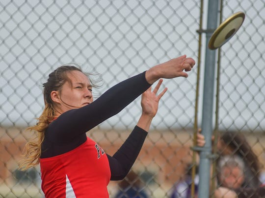 Pleasant's Grace White hurls the discuss during the Elgin Relays on Friday night at Elgin.