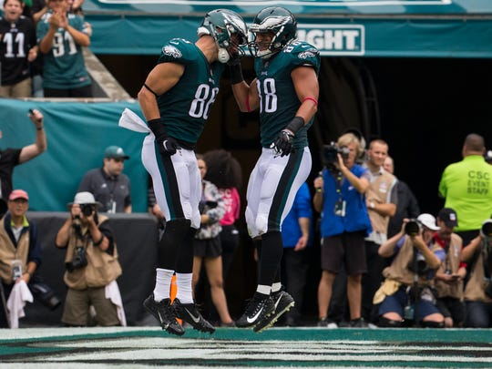 Zach Ertz and Trey Burton celebrate after an Eagles touchdown.