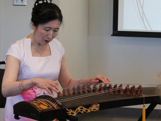 A member of the Atlantic Chinese Community Choir performs