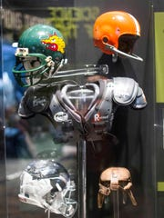 The evolution of football equipment is demonstrated