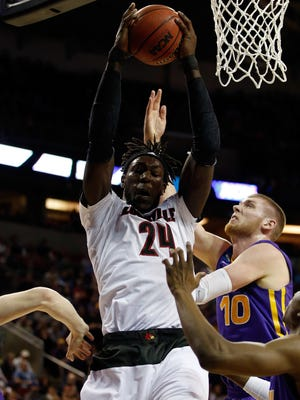 Montrezl Harrell (24) of the Louisville Cardinals rebounds the ball against Seth Tuttle (10) of the Northern Iowa Panthers in the second half of the game during the third round of the 2015 NCAA Men's Basketball Tournament at KeyArena on March 22, 2015 in Seattle.