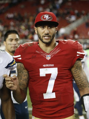 Former Nevada Wolf Pack star Colin Kaepernick is shown during a 2014 49ers game in California.