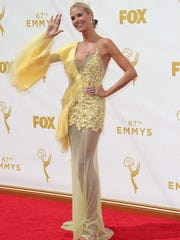 Heidi Klum arrives at the 67th Emmy Awards.