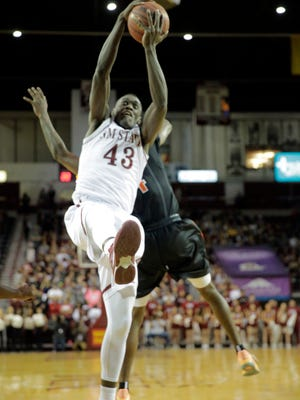 New Mexico State's Pascal Siakam goes up for the rebound during the first half of action against UTEP on Wednesday at the Pan American Center in Las Cruces.
