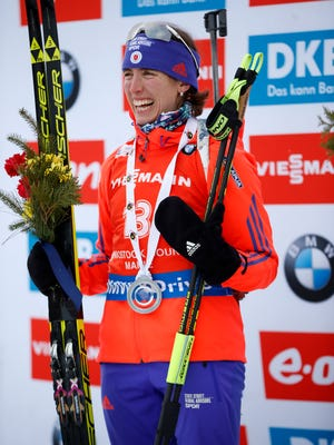 Susan Dunklee of Barton during flower ceremony after second place finish in the sprint competition during the World Cup Biathlon, Thursday in Presque Isle, Maine.