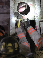 Carroll firefighters break apart a chimney to free