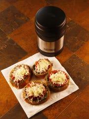 Open-faced charred tomato crostini with Pesto and Mozzarella from Robin Miller.