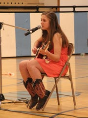 Riley Hader strums her guitar as she prepares for Cascade of Talent a few years ago. White Sulphur Springs students decided to start a statewide talent show after the Great Falls show was canceled.