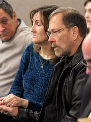 Sarah Stern's father Michael Stern listens during a