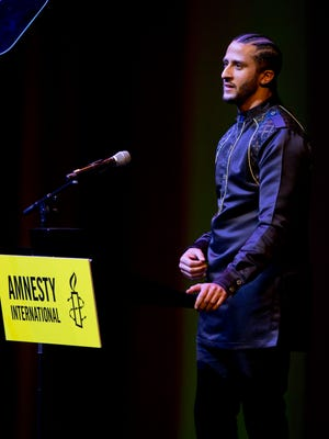 Former NFL quarterback and social justice activist Colin Kaepernick speeches after receiving the Amnesty International Ambassador of Conscience Award for 2018 in Amsterdam.