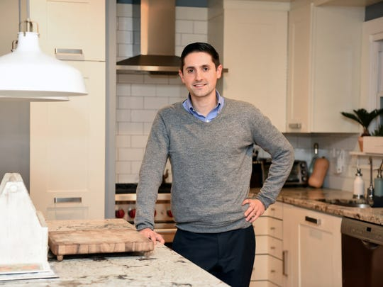 Rob Denicola and his wife, Christine, love the convenience of living in Paramus. The couple moved to town from New York City over two years ago. Denicola is photographed in the couple's Marion Lane home.