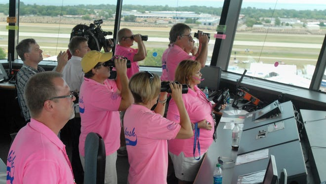 Air traffic controllers, spotters and other volunteers work the control tower during EAA AirVenture 2012 at Wittman Regional Airport.