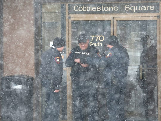 Police investigate a bank robbery at Associated Bank on South Main Street Thursday afternoon.