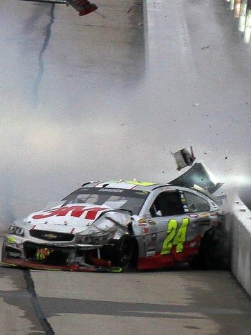 Jeff Gordon (24) hits an unprotected interior wall