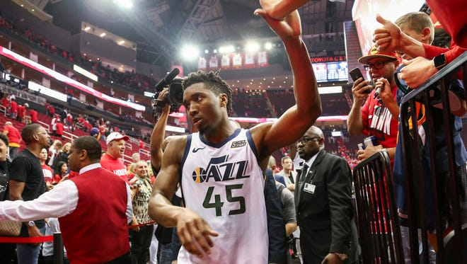 Utah Jazz guard Donovan Mitchell (45) walks off the court after the Jazz defeated the Houston Rockets in game two of the second round of the 2018 NBA Playoffs at Toyota Center.