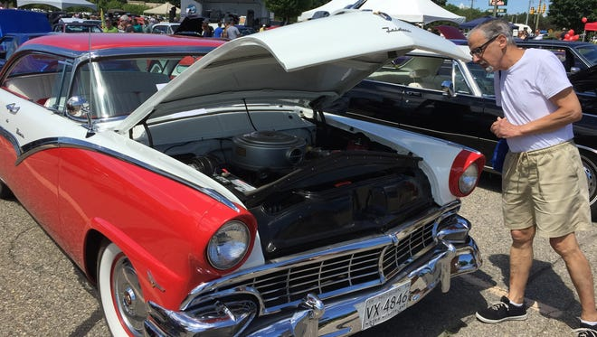 Larry Reynolds, of Fort Gratiot, admires a 1956 Ford Victoria at the Keith Peterson Memorial Car Show in Fort Gratiot
