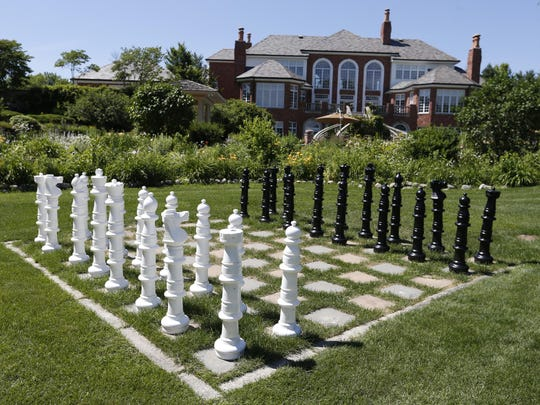 A lawn chess set in the backyard of the $5.6 million home in West Des Moines. The new listing is the most expensive home on the market in the area.