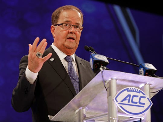 Duke football coach David Cutcliffe answers a question the ACC media day in Charlotte, N.C., on July 18.