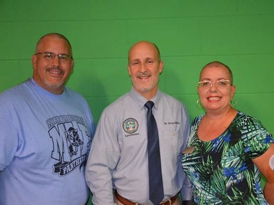 Staff shave heads for student success