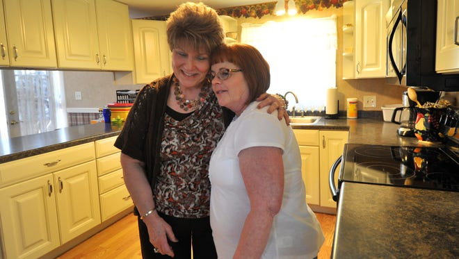 Interim HealthCare President Jan Kocha and Goldenrod home director Peggy Pranke share a hug in the facility after its closure last week. They're in the kitchen of Goldenrod Home for developmentally disabled adults in Rib Mountain.