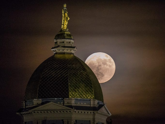 A full moon, referred to as a supermoon, rises over