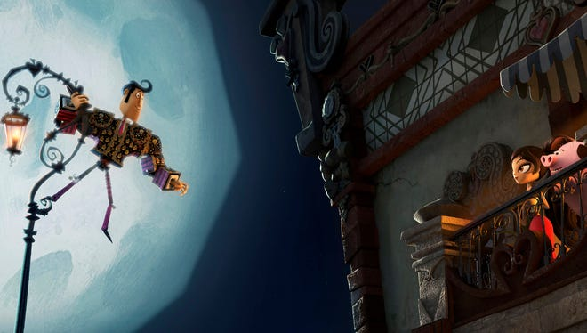 """Manolo, left, voiced by Diego Luna, is shown serenading Maria voiced by Zoe Saldana, the woman with whom he's long been in love, in a scene from the animated comedy, """"Book of Life."""""""