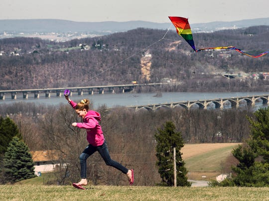 Hannah Lentz, 11, of Lower Windsor Township flies a kite at Samuel S. Lewis State Park Sunday April 6, 2014 in Lower Windsor Township. Across the Susquehanna River at top right is Columbia.