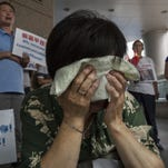 Chinese relatives demand 'truth' behind MH370 disappearance