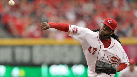 Reds starting pitcher Johnny Cueto delivers during the first inning Monday at GABP.