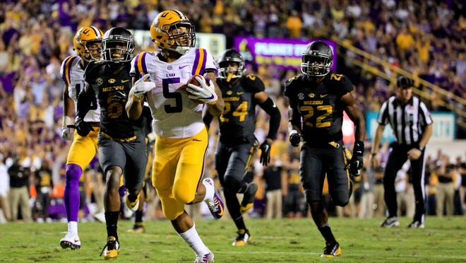 LSU Tigers running back Derrius Guice (5) scores a touchdown against the Missouri Tigers during the second quarter of a game at Tiger Stadium.