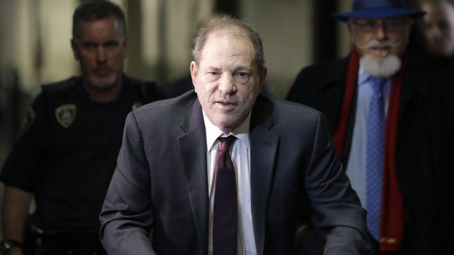 FILE - In this Feb. 20, 2020 file photo, Harvey Weinstein arrives at a Manhattan courthouse for his rape trial in New York.  Weinstein was sentenced Wednesday, March 11,  to 23 years in prison for rape and sexual assault.
