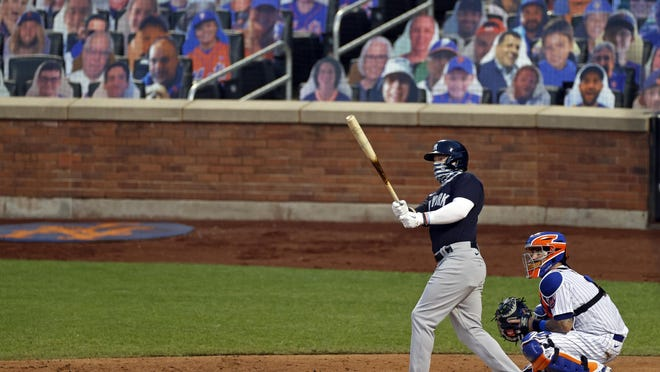 The New York Yankees' Clint Frazier, left, watches his two-run home run against the New York Mets during the fourth inning of a spring training game Saturday in New York.