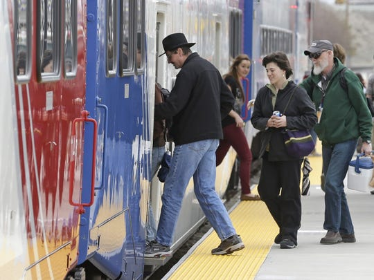 Commuters board the Frontrunner commuter rail line