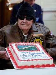 "Pearl Harbor survivor Stuart ""Bud"" Sweeney, 94, of Plymouth, holds a special sheet cake remembering the event during a program at the Ladewig-Zinkgraf American Legion Post 243 Wednesday December 7, 2016 in Plymouth."