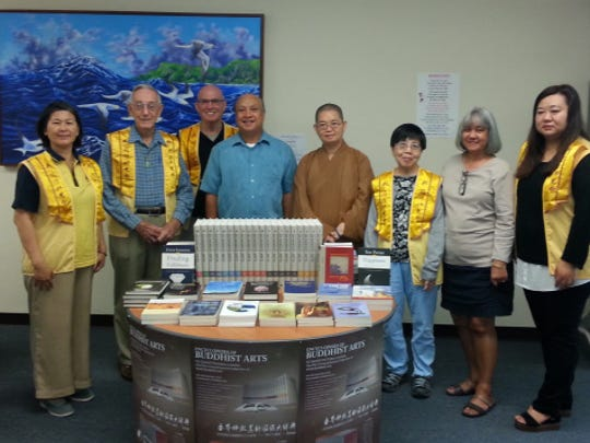 Guam Public Library System accepts a book donation