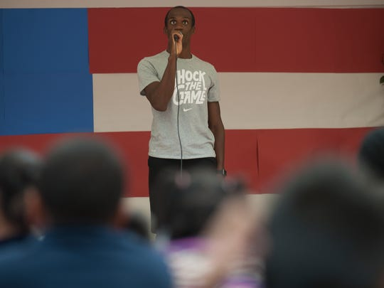 Lex Gillette, a blind Paralympian who mentors Cooper's Poynt students in Camden, speaks during a surprise visit to the school.