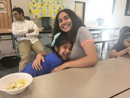 Niki Afshar at the Fellsmere Elementary School's After School Program with Selena in May of 2017.