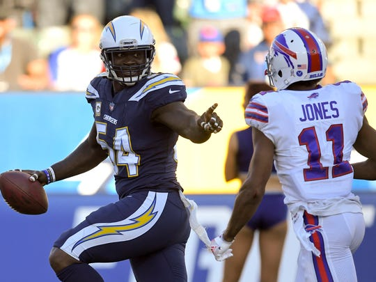 Los Angeles Chargers outside linebacker Melvin Ingram, left, scores past Buffalo Bills wide receiver Zay Jones during the second half of an NFL football game, Sunday, Nov. 19, 2017, in Carson, Calif. (AP Photo/Mark J. Terrill)
