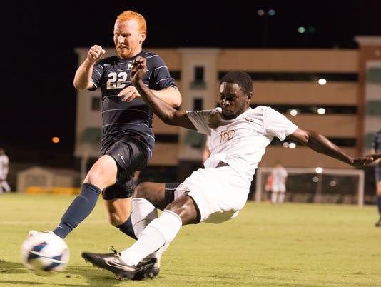UCF Mens Soccer v UNF_8 Midfield defender Tazeo Gilpin slides