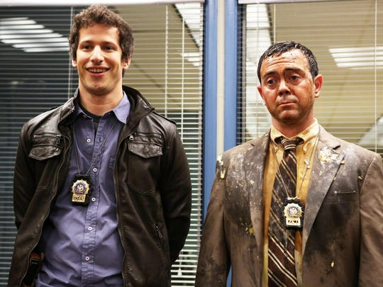 """This publicity image released by Fox shows Andy Samberg, left, and Joe Lo Truglio in """"Brooklyn Nine Nine,"""" premiering Sept. 17 at 8:30 p.m. EST. (AP Photo/Fox, Beth Dubber)"""