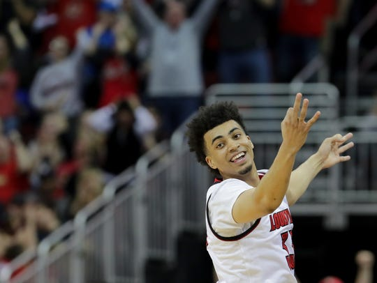 Louisville's Jordan Nwora celebrates after knocking down a 3.