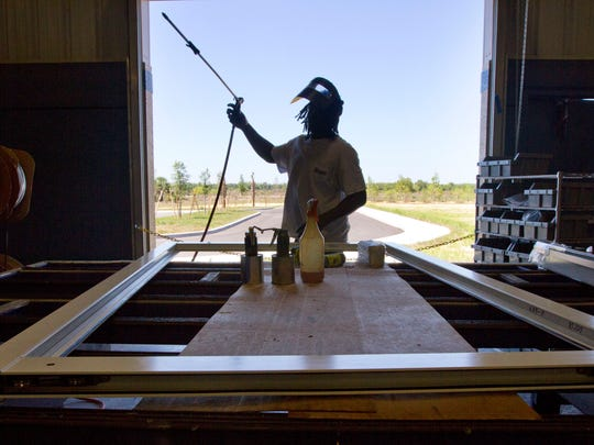 Timothy Simpson of Fort Myers assembles a metal sliding door frame while working at Eastern Architectural Systems, a division of Eastern Metal Supply.
