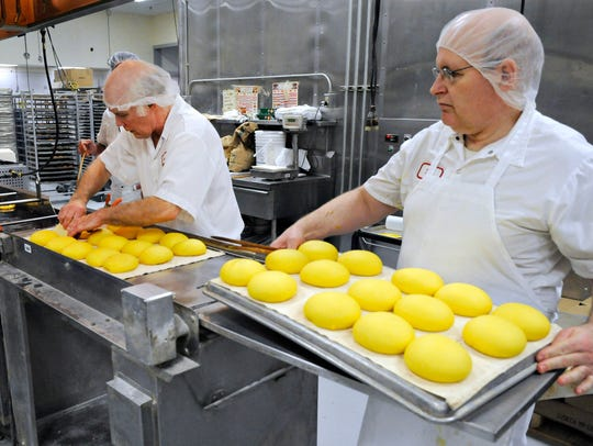 Bakers Carl Wesenberg and Rex Jungerberg make a deep-fried doughnut-like treat called paczki at Coborn's bakery in this 2015 photo.
