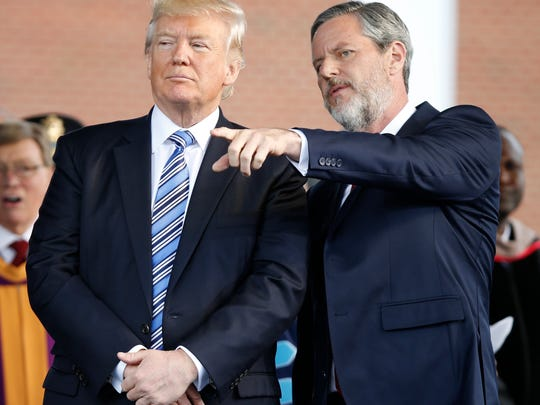 President Trump stands with Liberty University President Jerry Falwell Jr. in Lynchburg, Va.