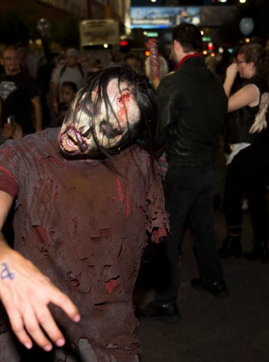 Zombies participate in Zombie Walk in downtown Phoenix on Saturday, Oct. 29, 2016.