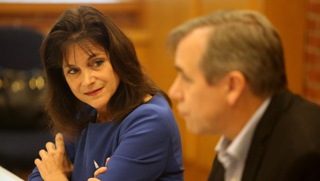 Monica Wehby listens to Sen. Jeff Merkley while they talk with the Statesman Journal Editorial Board on Saturday, Oct. 18, 2014,  in Salem.