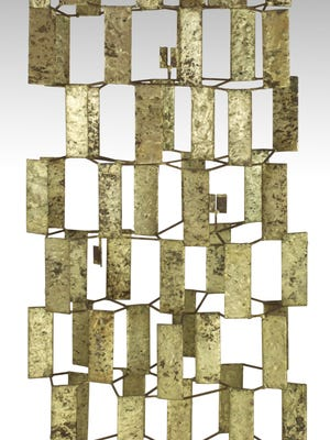 This brass and copper sculpture by Harry Bertoia sold on New Year's Day at auction for $120,000.