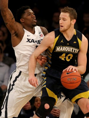 Xavier Musketeers forward Jalen Reynolds (1) puts pressure on Marquette Golden Eagles center Luke Fischer (40) in the first half of the Big East Men's Basketball Tournament at Madison Square Garden in New York City Thursday, March 10, 2016.