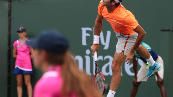 Roger Federer, of Switzerland, serves to American Jack Sock on Wednesday at the BNP Paribas Open in Indian Wells. Federer won the match 6-3, 6-2.