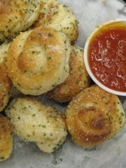 """Our garlic knots are famous around here,"" says Guy"